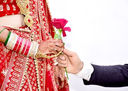 Indian Groom gives Rose flower to bride in wedding