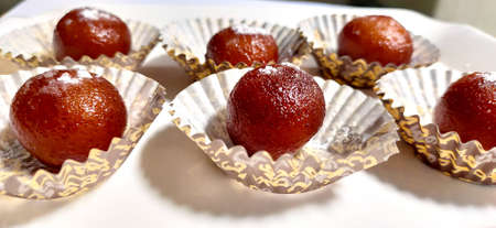 An indian Sweet Gulab Jamun is a Syrupy Dessert Popular in India Stock Photo