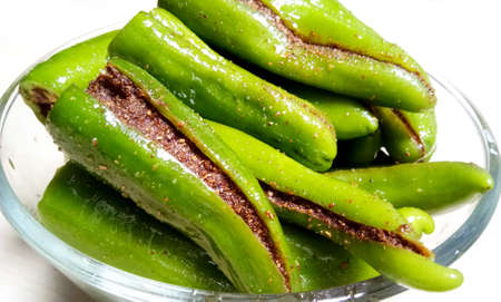 Indian Spicy Green Chilli Pickle Also Know as Mirchi Ka Achaar or Loncha Isolated on White Background