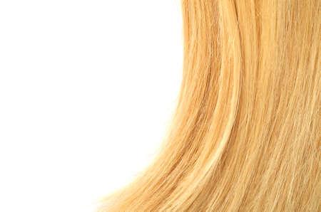 Blond haar geïsoleerd op wit Stockfoto