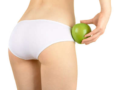 Concept image of a woman holding green apple