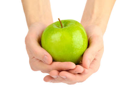 Green apple in man hands isolated on white