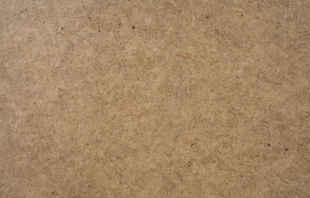 hardboard: A texture of hardboard or masonite, the material often used for pegboard.