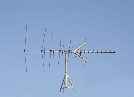 whatever: Uhf Vhf Television Antenna Isolated against a blue sky to put on whatever you like! Stock Photo