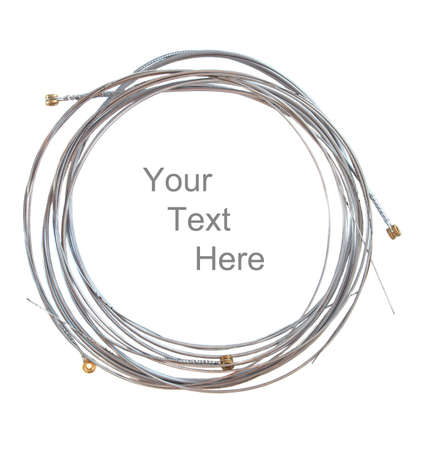 strat: A stack of coiled up flat wound electric guitar strings isolated on white
