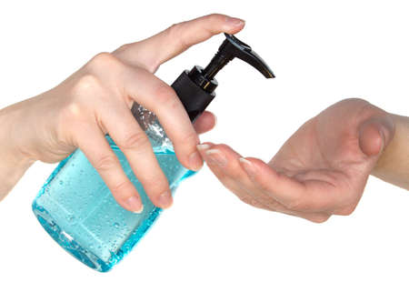 Lady applying a moisturizing hand sanitizer to dry hands photo