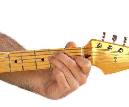 fingering: Demonstration of how to play a E chord on the guitar Stock Photo