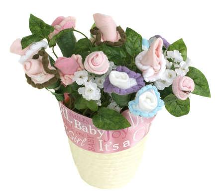 comprised: Fiori composto da calze bambino crescono da un vaso di fiori avvolto con un nastro.