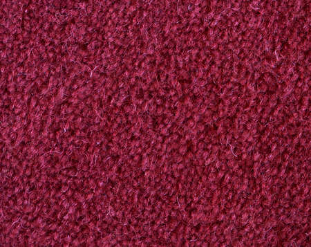 red carpet background: Macro of a red carpet woven from wool. Stock Photo