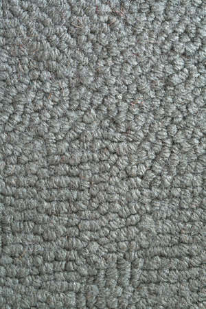 carpet and flooring: Macro of a green colored woven rug Stock Photo
