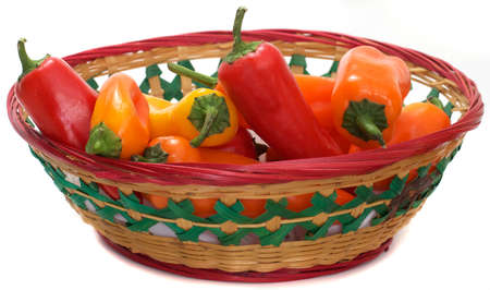 Ripe Multicolored Mini Sweet Bell Peppers in a Colorful Mexican Basket photo