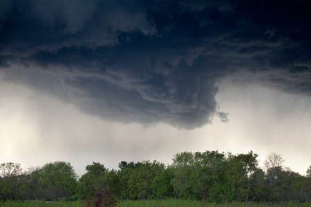 HDR image of a wall cloud,  ready to drop a tornado. photo