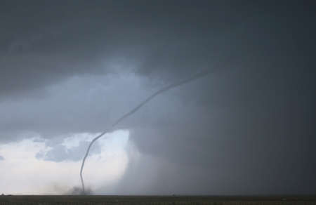 twister: A roped out tornado, just before it lifts back into the clouds