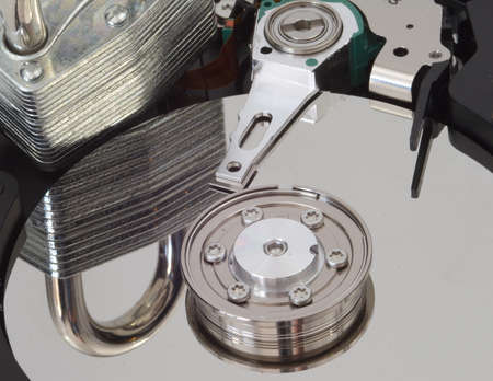 A strong lock reflected in a harddrive. photo