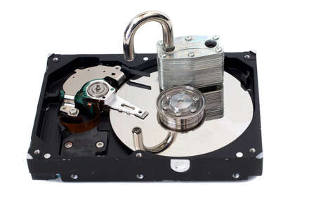 A strong padlock unlocked on top of a hard disk drive.  Depicts a lack of security. photo
