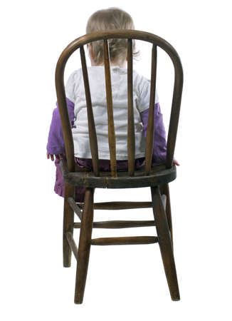 disobedient: Little Girl Sitting in a Time Out Chair Stock Photo