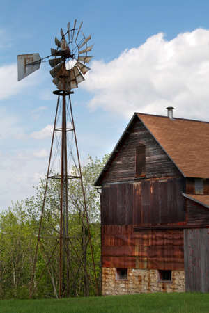 An old abandoned farm barn and windmill photo