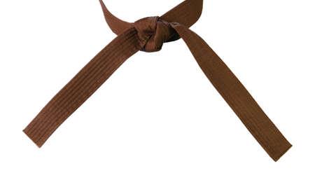 jujitsu: Tied Karate brown belt closeup isolated on white background
