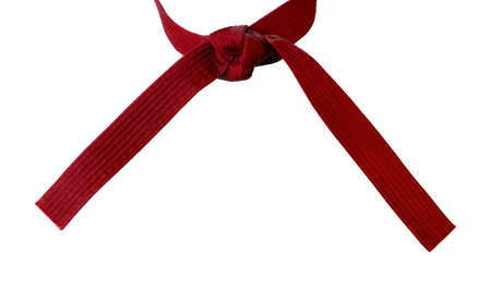 Tied Karate red belt closeup isolated on white background photo