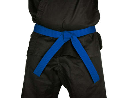 black belt: Karate blue belt tied around marital artists torso wearing black dojo GI