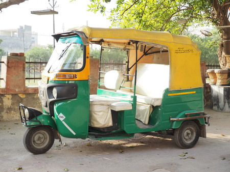 A tuk tuk taxi car yellow and Green   colour car,  DELHI, INDIA Editorial