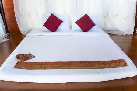 Asian-style massage mattress on wooden floor