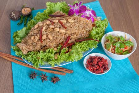salad decoration: Thai spicy salad with catfish menu (thai food) with background (shooting set menu) Stock Photo