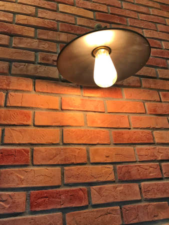 warm light with brick wall background Banco de Imagens