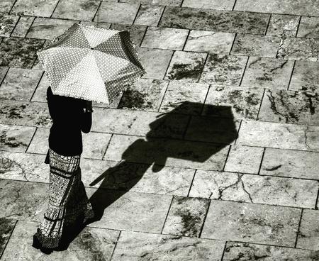 sun umbrellas: women under sun umbrellas