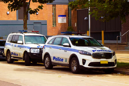 Marked police cars parked outside a local area police station 写真素材