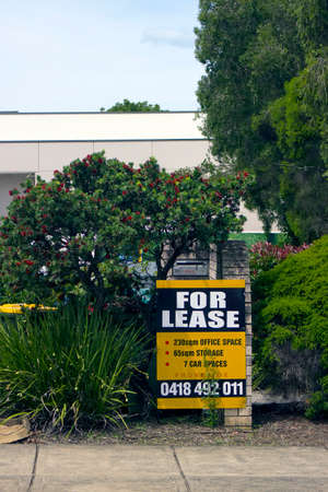 A For Lease Sign outside Offices in a tree and garden rich suburb