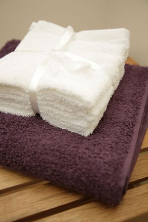 twol towels on white on purple photo