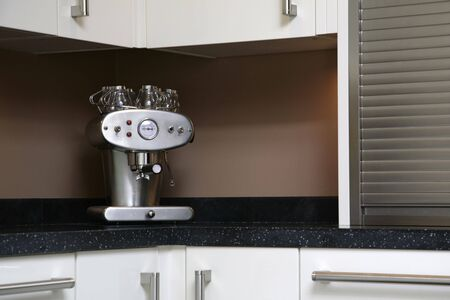 A Luxury coffee machine sits atop a work surface photo