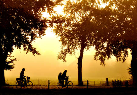 Silhouette of two bicyclers at sunset