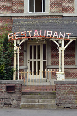 rundown: Seedy Restaurant - Entrance of a run-down Restaurant in Belgium