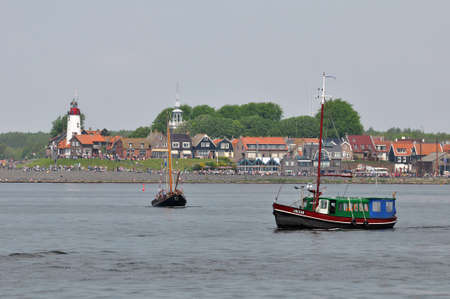 Urk, The Netherlands, May 19, 2012 - Old fishing boat UK 238 in front of the former island of Urk, during a National fisheries festival .