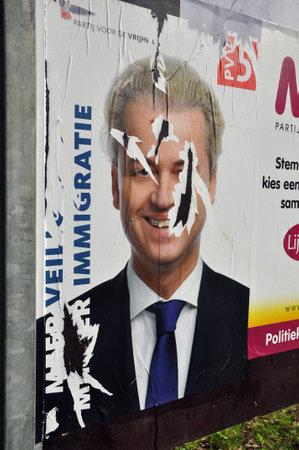 parlamentario: Cartel da�ado de Geert Wilders, l�der del Partido Parlamentario de Freedom House de Representantes de los Pa�ses Bajos Editorial