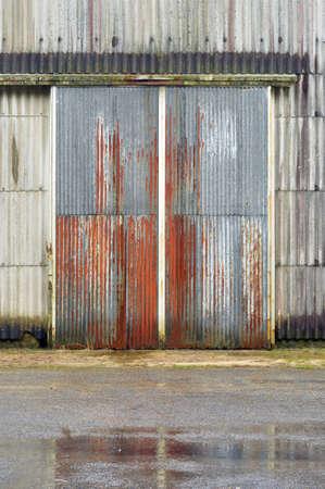 galvanised: A building of corrugated fiber cement with a door of corrugated galvanised iron