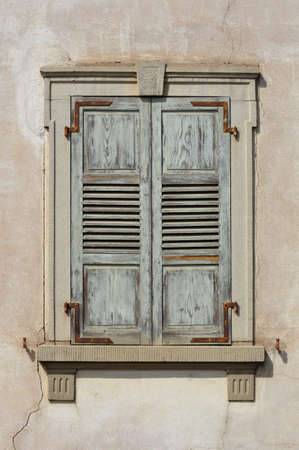 shut: Closed old shuttered weathered wooden window in the Alsace, France Stock Photo