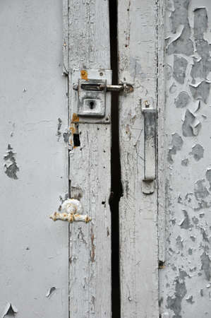 Latch and lock on painted old door  photo