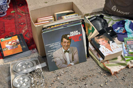 jane: BELGIUM - August 07, 2010 : A record of Dean Martin and a book of Jane Fonda on a flea market  Editorial