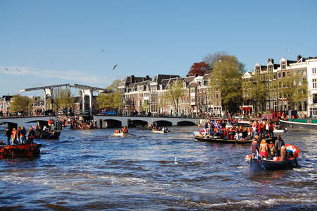 cruiseboat: Amsterdam, The Netherlands - April 30, 2013 : Celebration of queensday on the Amstel river