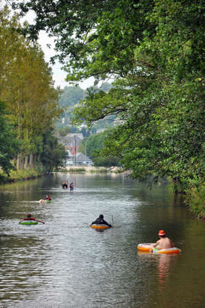 floatable: Floating Boy Scouts on the Ambleve near Stavelot, a river in the Ardennes of Belgium Editorial