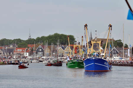 Urk, The Netherlands - May 19 : Fishing ships filled with public are leaving the harbor during the National fisheries festival on may 19, 2012, Urk, The Netherlands