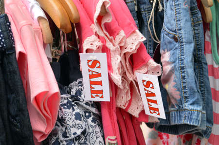 short sale: Kids Fashion labelled by a sale sign