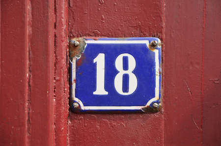 factorial: House Number Eighteen sign on red wooden panel Stock Photo