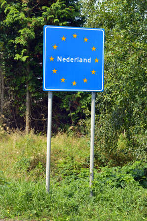 nederland: Sign of Nederland at the border of Germany and The Netherlands