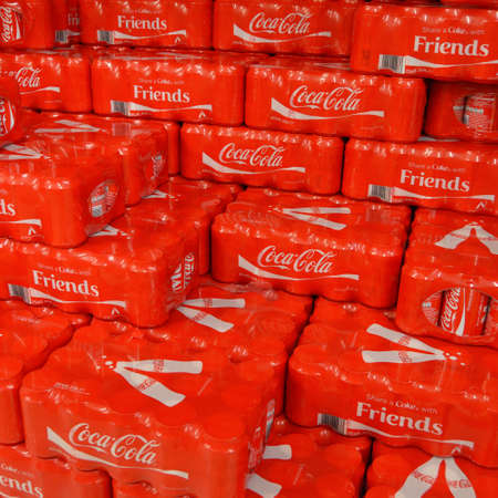A Pallet with 15-packs of shrink wrapped  Coke cans