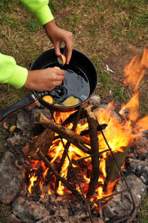 smut: Campfire cooking - Frying pan with egg on Campfire