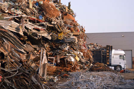 Metal scrap yard with Truck in the industrial area photo